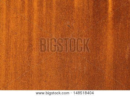 Heavily worn red peeled rusty wall