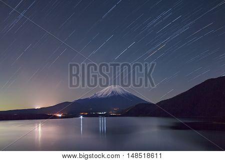 Mount Fuji and Lake Motosu at starry night in winter season