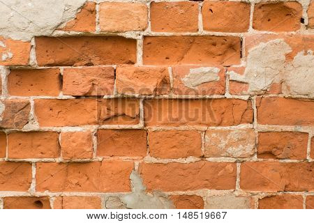 Brick wall made of red stone with a pronounced texture