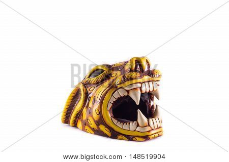 Statue head of a Jaguar with open mouth and big white teeth on white background