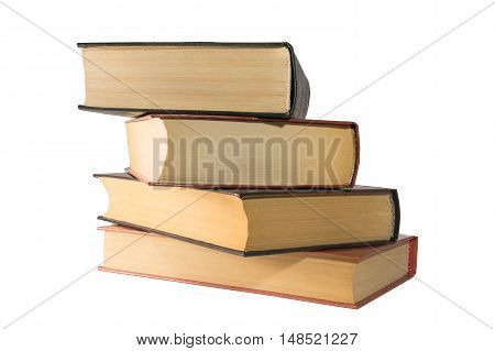 A stack of books out of the four pieces on white background