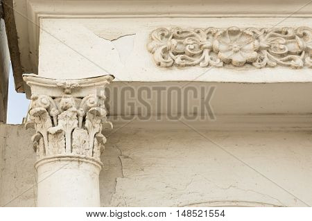 Ancient column with stucco and gate with a bas-relief in Yaroslavl