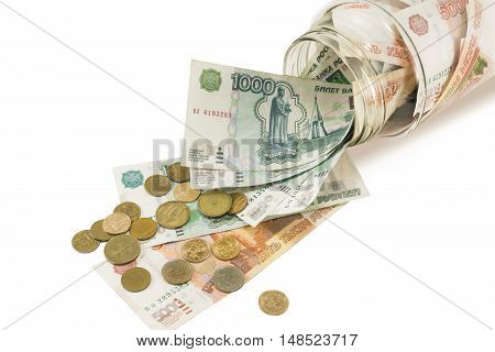 Bank with money dollars euros and scattered coins on a white background