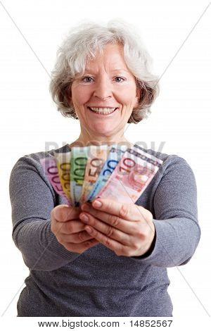 Senior Woman Holding Banknotes