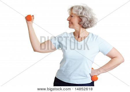 Retired Woman Exercising With Dumbbells
