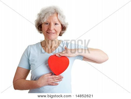Senior Woman Holding Red Heart