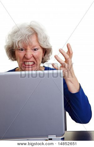 Angry Senior Woman With Laptop