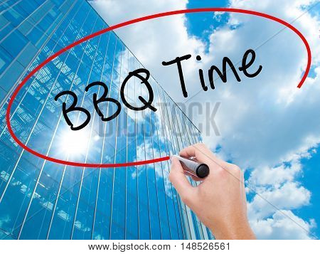 Man Hand Writing Bbq Time With Black Marker On Visual Screen