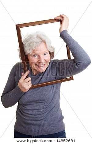 Elderly Woman Putting Head Through Frame