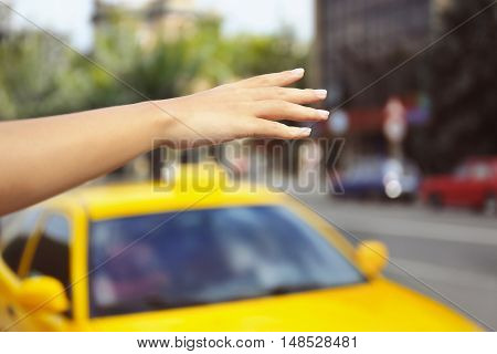 Woman stopping taxi, outdoor