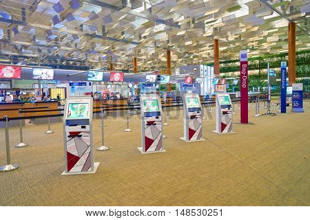 SINGAPORE - CIRCA AUGUST, 2016: self check-in kiosks at Changi Aiport. Changi Airport is the primary civilian airport for Singapore.
