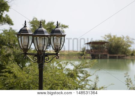 Street lamp over the pond and gazebo