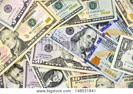 Money background. A lot of different dollars bills.