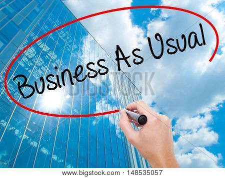 Man Hand Writing Business As Usual With Black Marker On Visual Screen