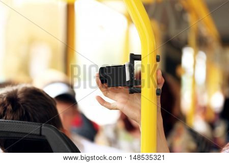 Hand pressing punch on the public transport