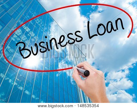 Man Hand Writing Business Loan With Black Marker On Visual Screen
