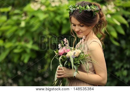 Beautiful bridesmaid holding bouquet