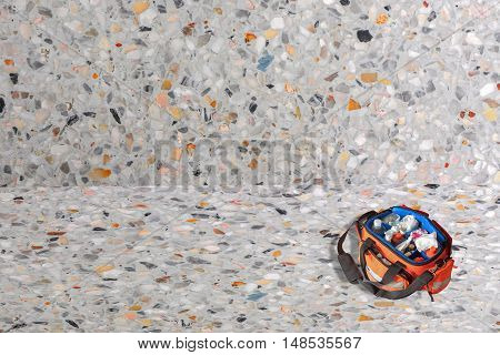 First aid kit with Bag and medicine assist patient in emergency rescue situation on Terrazzo Floor texture polished stone background