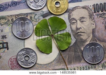 Four leaf clover shape money cash coin currency yen japanese