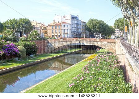 Tet River And A Bridge In Perpignan Between Some Buildings, France