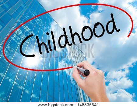 Man Hand Writing Childhood With Black Marker On Visual Screen