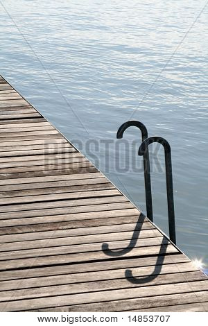 Wooden waterside walkway with ladder into the water