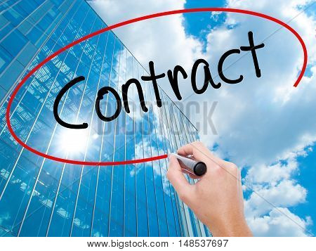 Man Hand Writing Contract With Black Marker On Visual Screen