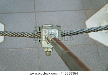 Metal mount consisting of bolts and cables to secure the radio transmitting antennas