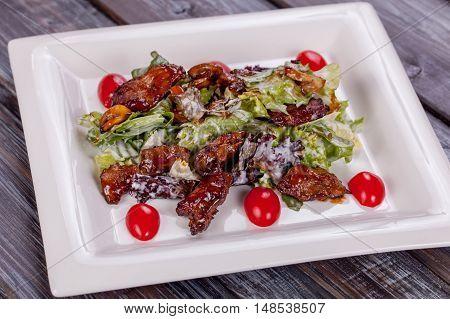 salad chicken in teriyaki sauce on white plate