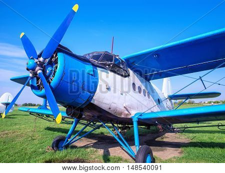picture of an old biplane on the ground