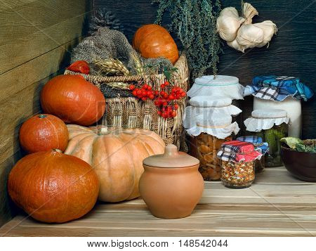 Storage reserves in the pantry. Canning. The harvest from the garden garden. Banks with cucumbers and mushrooms. Pumpkins.