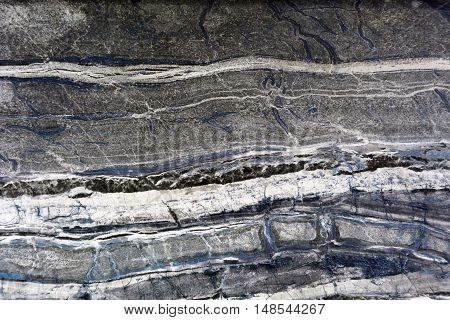 Horizontal 3:2 format full frame grey and black marble background.