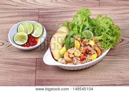Fried  rice with mixed vegetable and side dish. Side view.