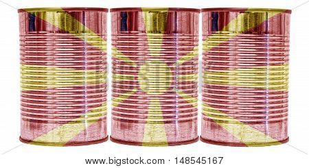 Three tin cans with the flag of Macedonia on them isolated on a white background.