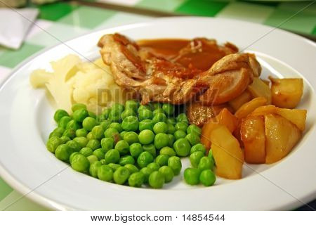 Pork chops with peas and potatoes restaurant setting