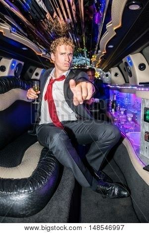 Man With Champagne Flute Pointing At You In Limousine