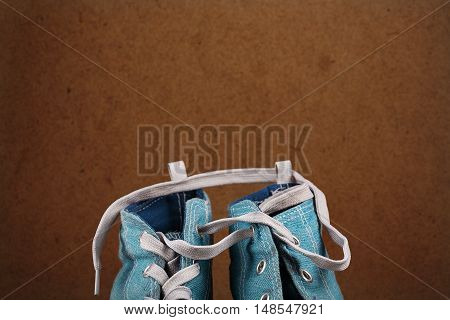 The top of pair blue sneakers with one drawstring