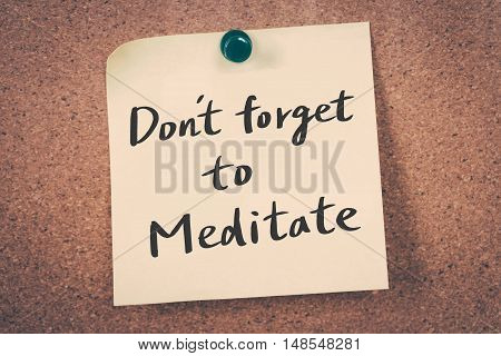 Don't forget to meditate. note pin on the bulletin board