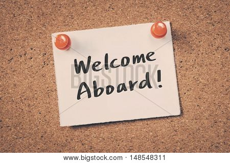 Welcome Aboard. note pin on the bulletin board