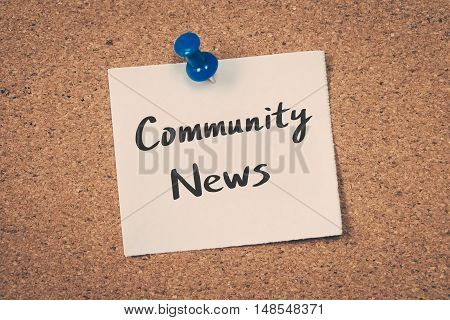 Community News. note pin on the bulletin board