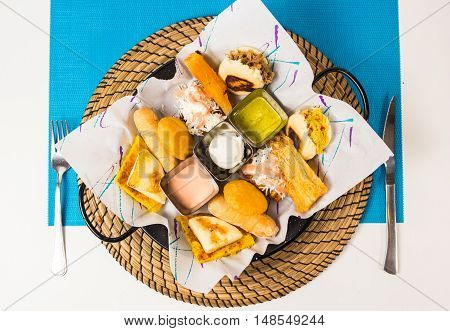 Tasting dish with venezuelan typical food .