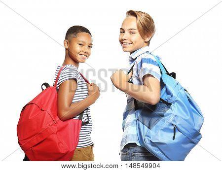 Cute schoolchildren, isolated on white