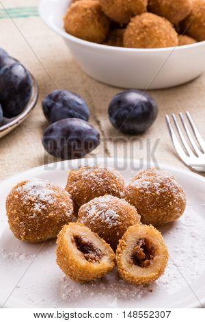 Plum Dumplings On White Plate