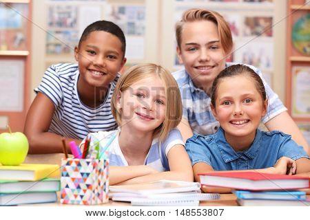 Cute schoolchildren in classroom on lesson