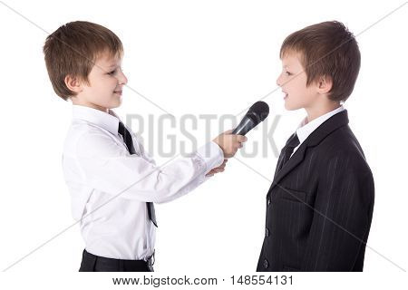 Cute Little Boy Reporter With Microphone Taking Interview Isolated On White