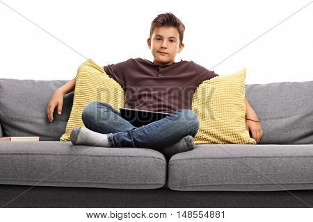 Bored boy sitting on a sofa isolated on white background