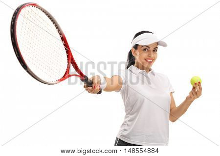 Cheerful female tennis player holding a tennis ball and a racket isolated on white background
