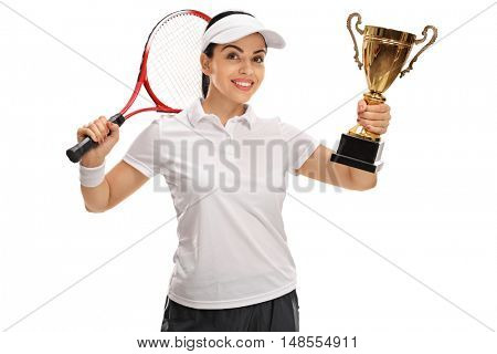 Happy female tennis player holding a gold trophy and a racket isolated on white background