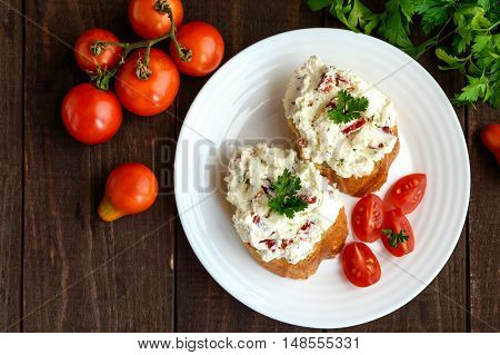 Sandwiches with pate cheese garlic slices of pepper dill. Organic health food. A healthy breakfast. The top view