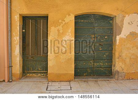 Old wooden doors in Marano Lagunare in Friuli Venezia Giulia north east Italy.